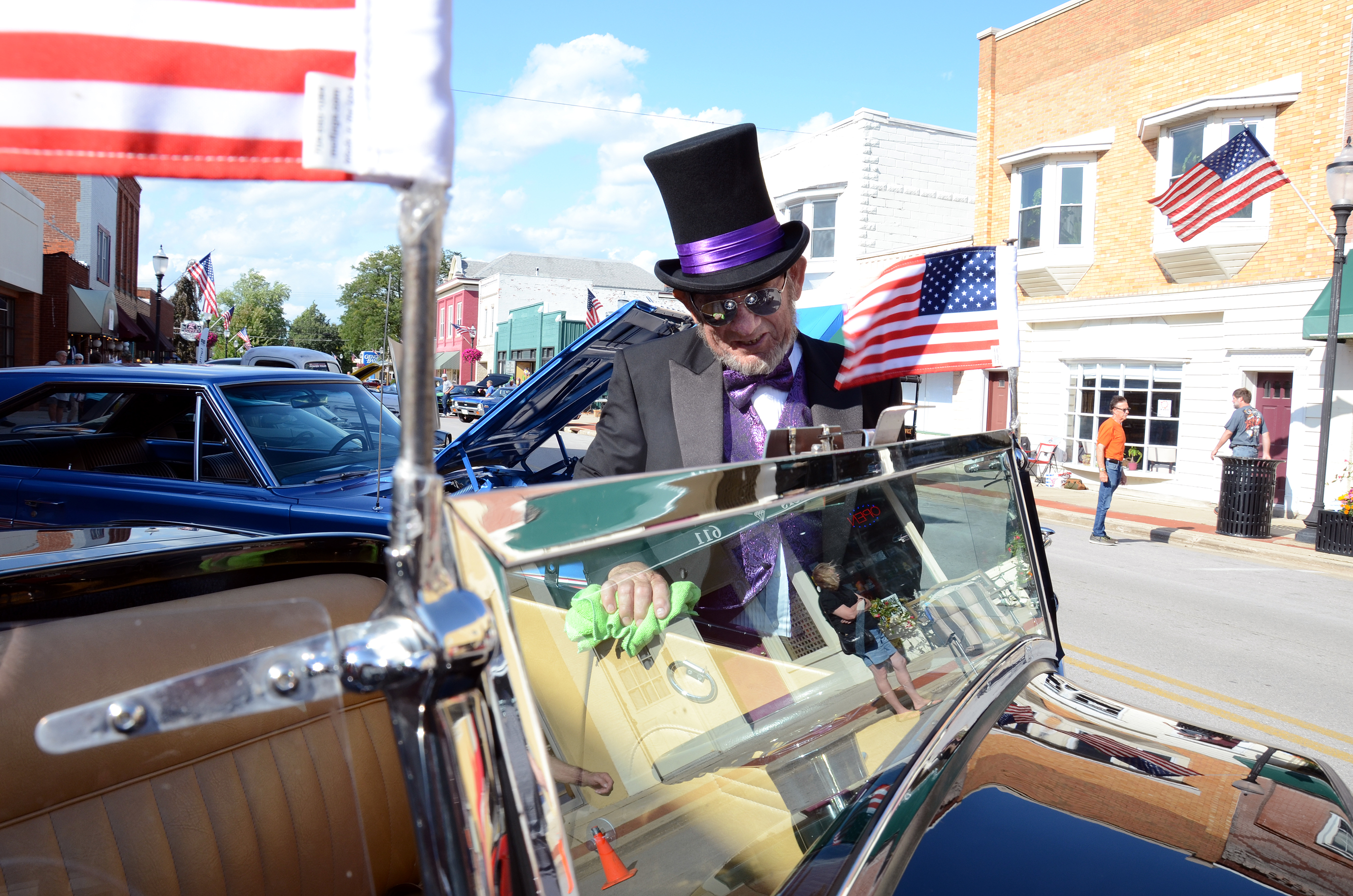 Decked out in top hat and tux, Dave Bertok, Genoa, polishes his 1932 Ford Roadster as cars begin to roll-in for Genoa's Super Cruise-In Car Show. (Press photo by Ken Grosjean)