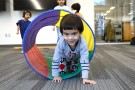 The Walbridge Branch Library offers Kinderskills, a program that helps children from ages 3-6 develop motor skills in preparation for  kindergarten, on Tuesdays at 2 p.m. Pictured, Unnat Aggarwal maneuvers her way through a tunnel. (Press photo by Ken Grosjean)