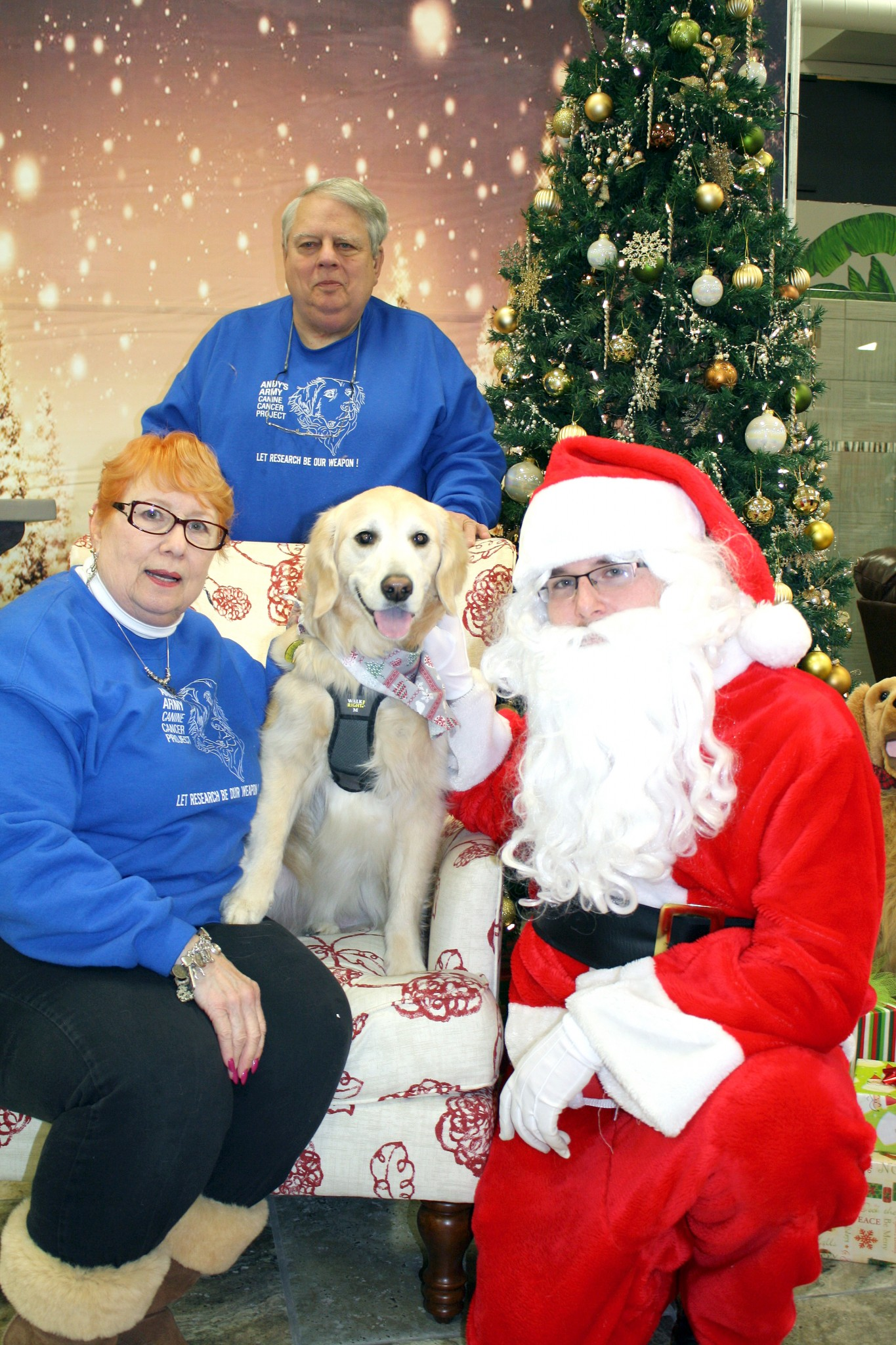 "Kae and Gary Heil with their dog Gabbie say ""cheese"" with Santa. Photos with Santa will be offered Sunday, Dec. 8 from 10 a.m.-4 p.m. at the Gladieux Home Center, 5120 Navarre Ave., Oregon. The event is a fundraiser for Andy's Army. (Submitted photo)"