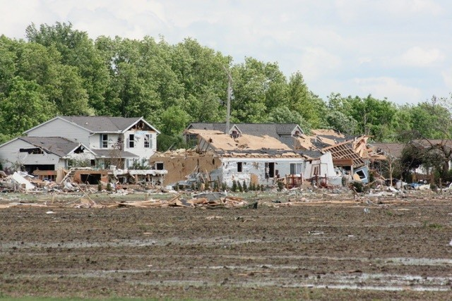Betty Hyre captured this photo of a small portion of Main Street the morning after the tornado, as seen from across the field. (Photo by Betty Hyre)