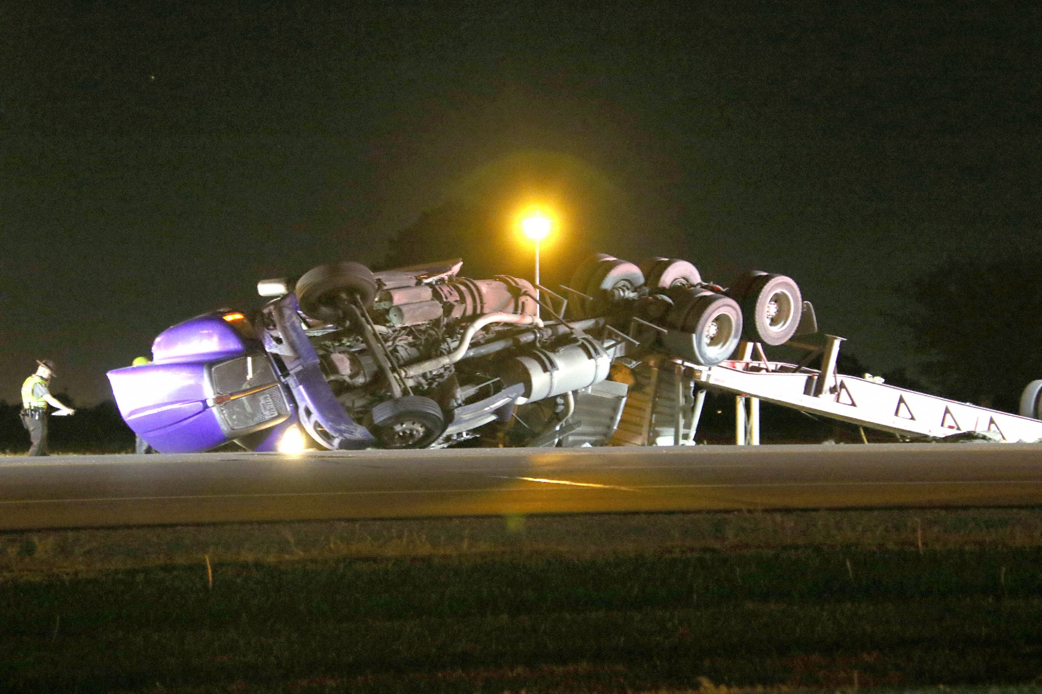 No injuries were reported after a truck traveling on State Route 579 overturned near the intersection with Woodville Road. The accident occurred May 23 around 9:10 p.m., according to the Ohio Highway Patrol. Jimmy D. Babineaux, Houston, Texas, was cited for failure to maintain control. The truck was hauling steel coils. (Press photo by Harold Hamilton HEHPhotos.smugmug.com)