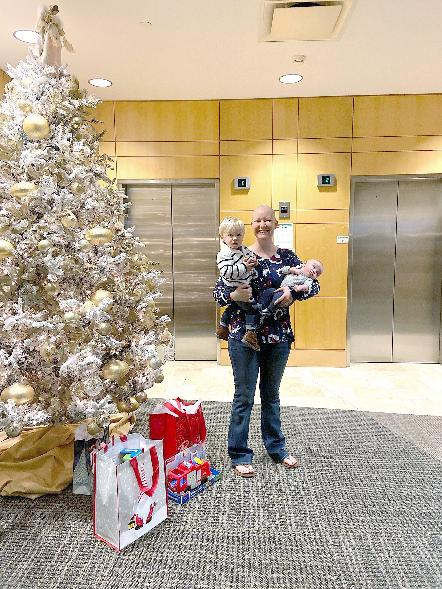 Heather Haynes and her sons, Grayson (left) and Ashton (right), were invited to Bay Park Hospital's Tree Lighting on Dec. 4 where Haynes lit the tree. (Photo submitted by ProMedica Bay Park Hospital.)
