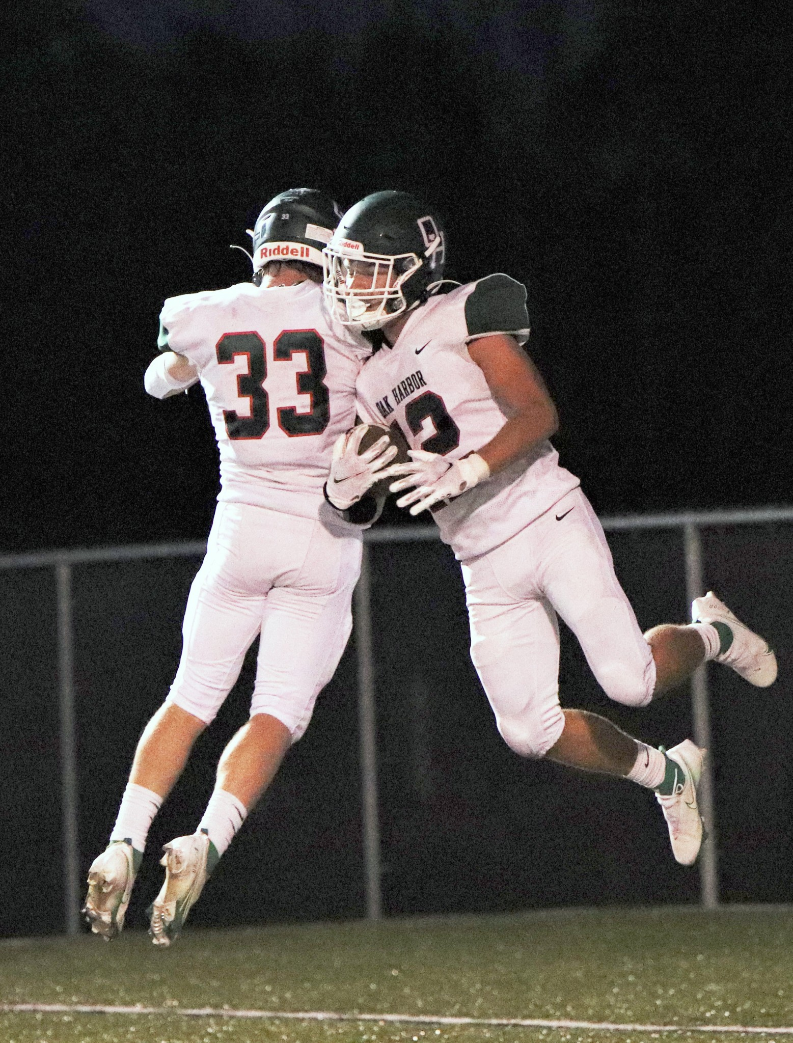 fter senior running back Eli Sherman scores in the Rockets' 69-17 Division V playoff rout over visiting Doylestown Chippewa, he and senior wide receiver  Nicholas Wirkner (33) celebrate in the end zone (right). (Photo by Laura Bolander)