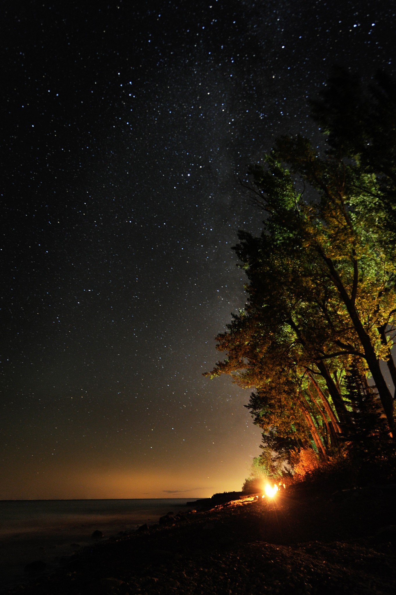 The Milky Way shows big and beautiful in the dark skies along Minnesota's North Shore of Lake Superior. This campfire view is from the Beach house near Two Harbors, Minnesota. (Photo by Art Weber)