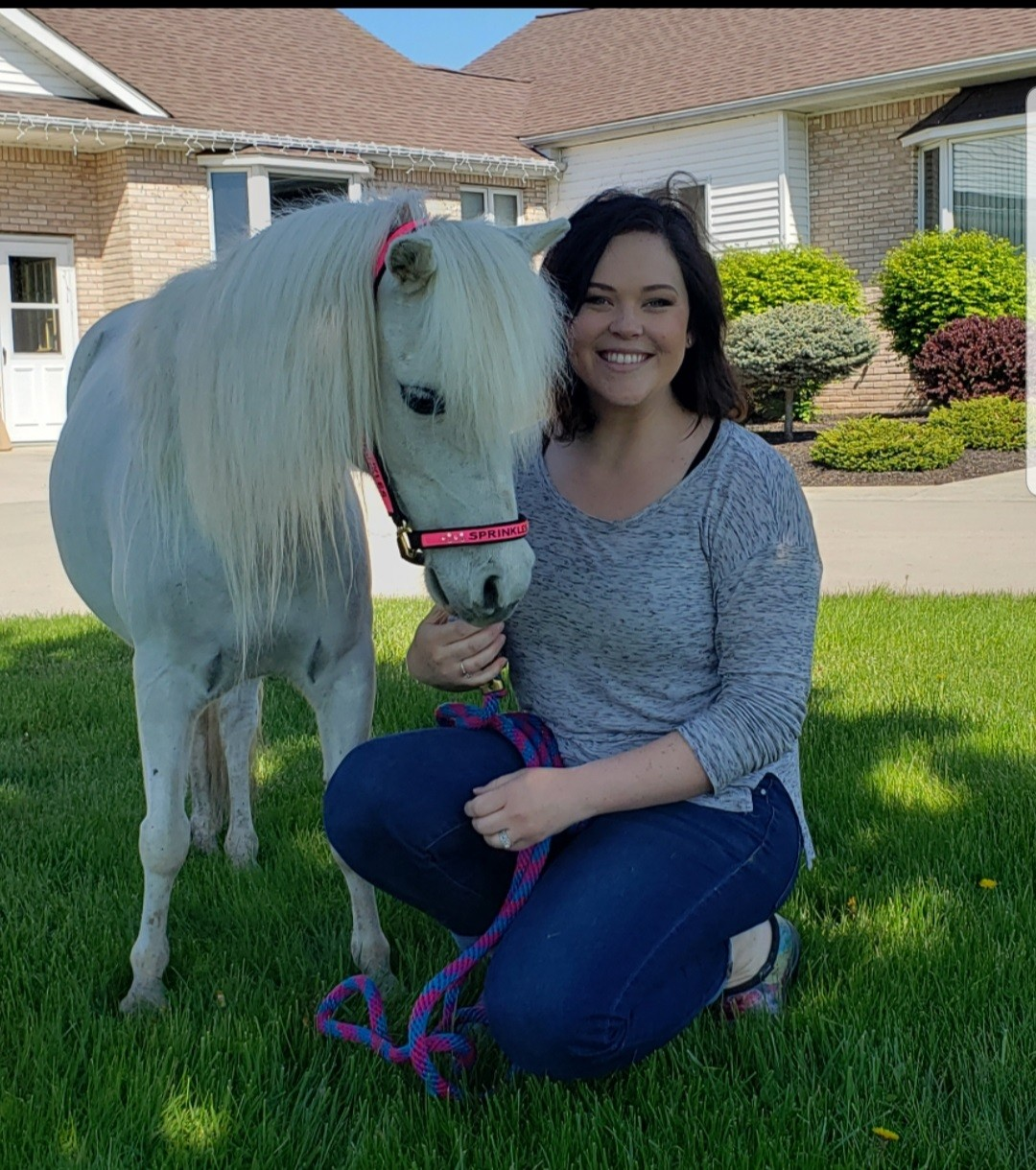 Sprinkles, the miniature horse, and her handler, Laura Laffey, are a registered pet partners therapy team. (Press photo by Kari Myers)