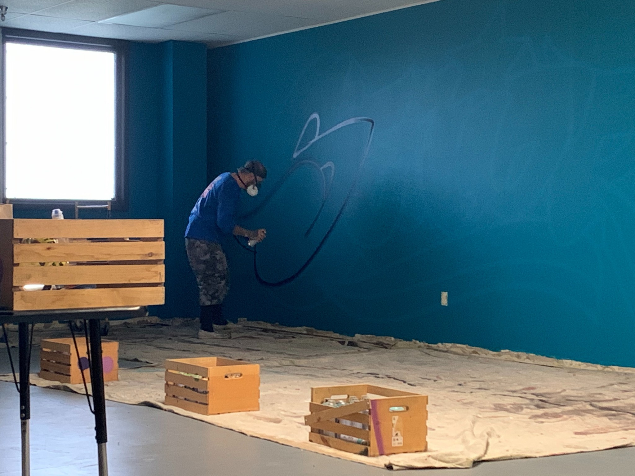 Tony Touch in the early stages of painting graffiti at Summit Academy Toledo. (Submitted photo)