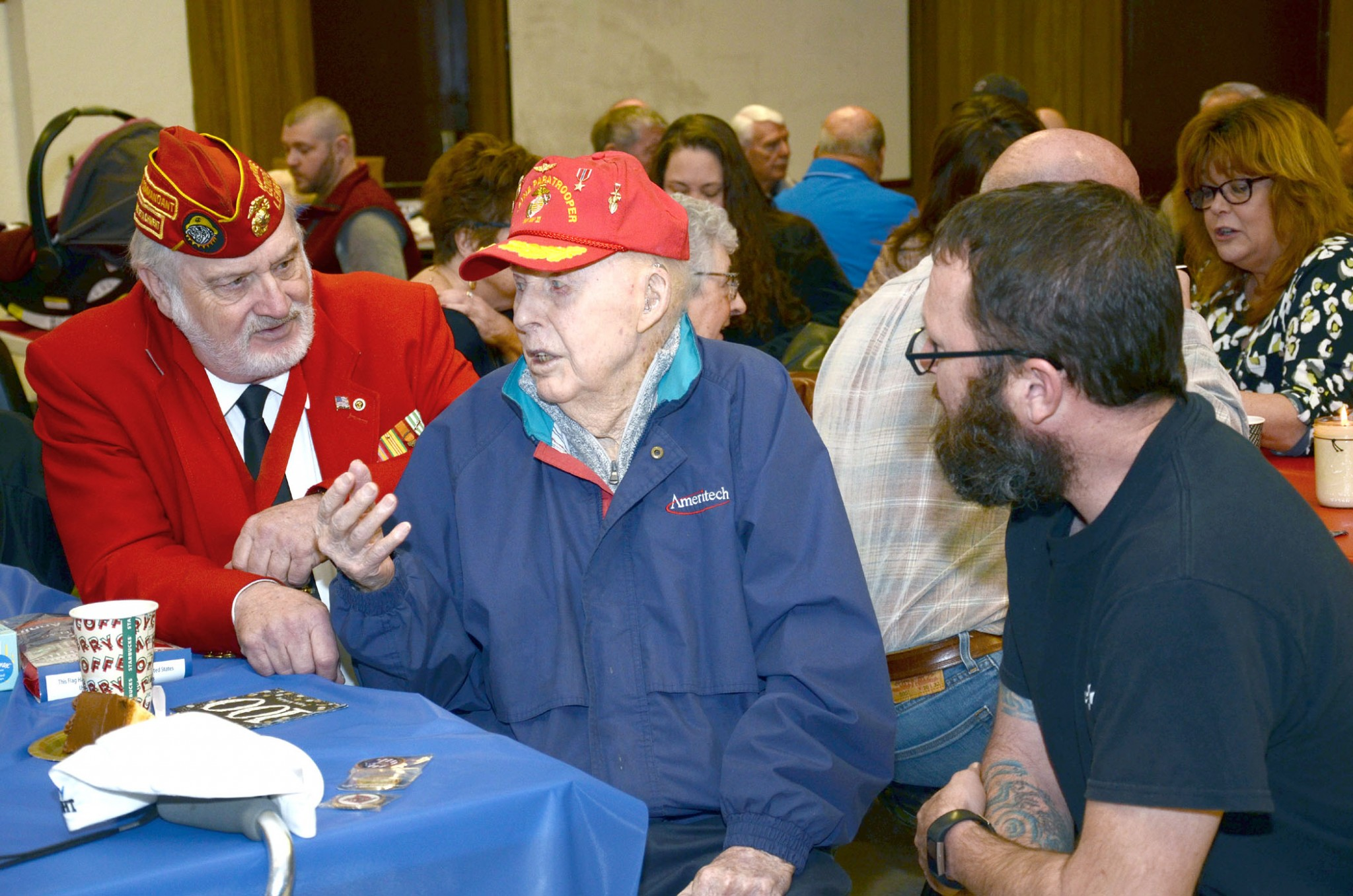 Tom Siefke talks with Bob Baker, left, commander of Marine Corp League Lou Diamond Detachment 272 and James Jacob, 1st sergeant, retired, 1st Battalion, 24th Marines. (Press photo by Ken Grosjean)