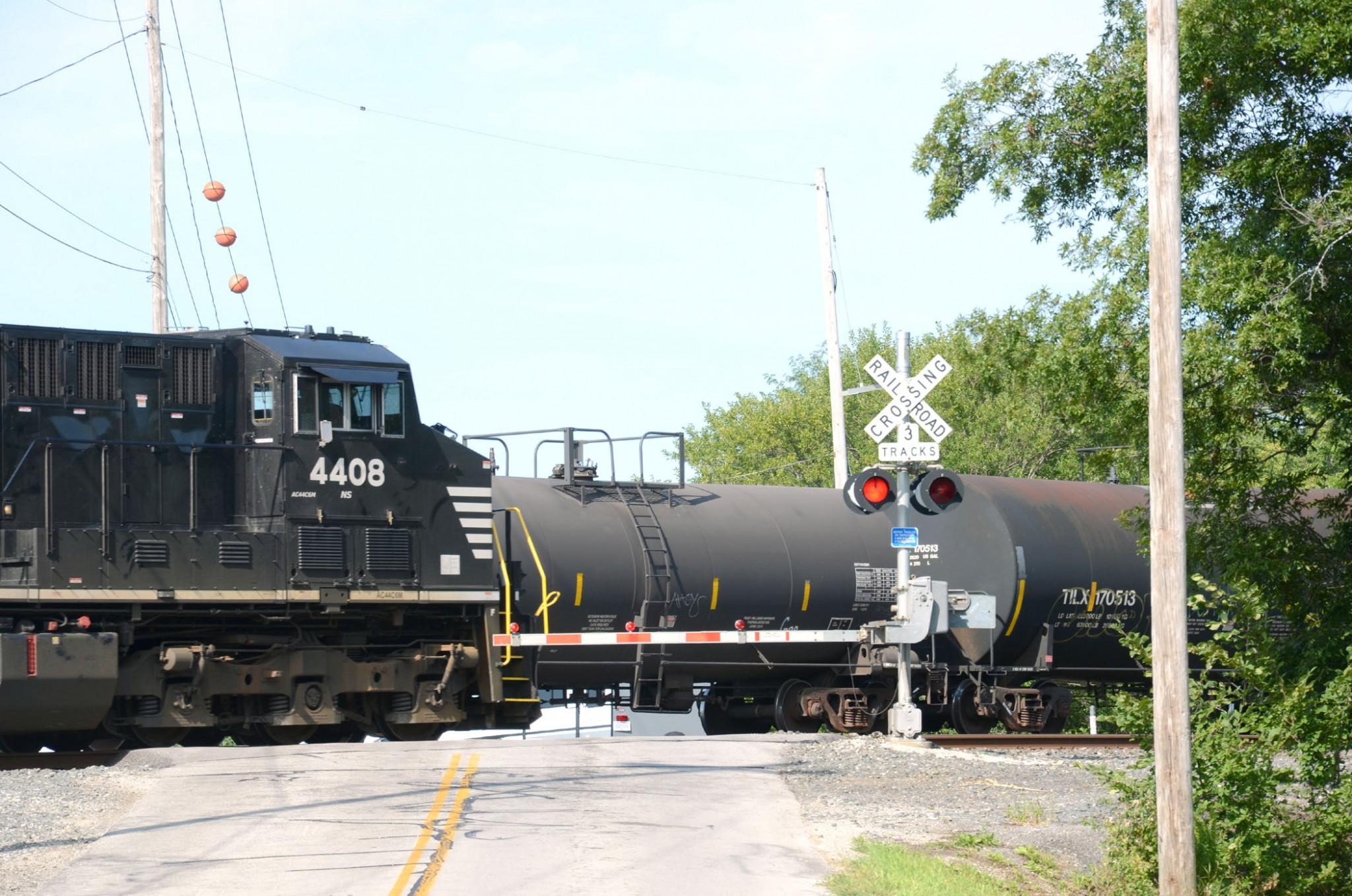 The train blocks Walbridge Rd. as another train approaches. (Press photo by Ken Grosjean)