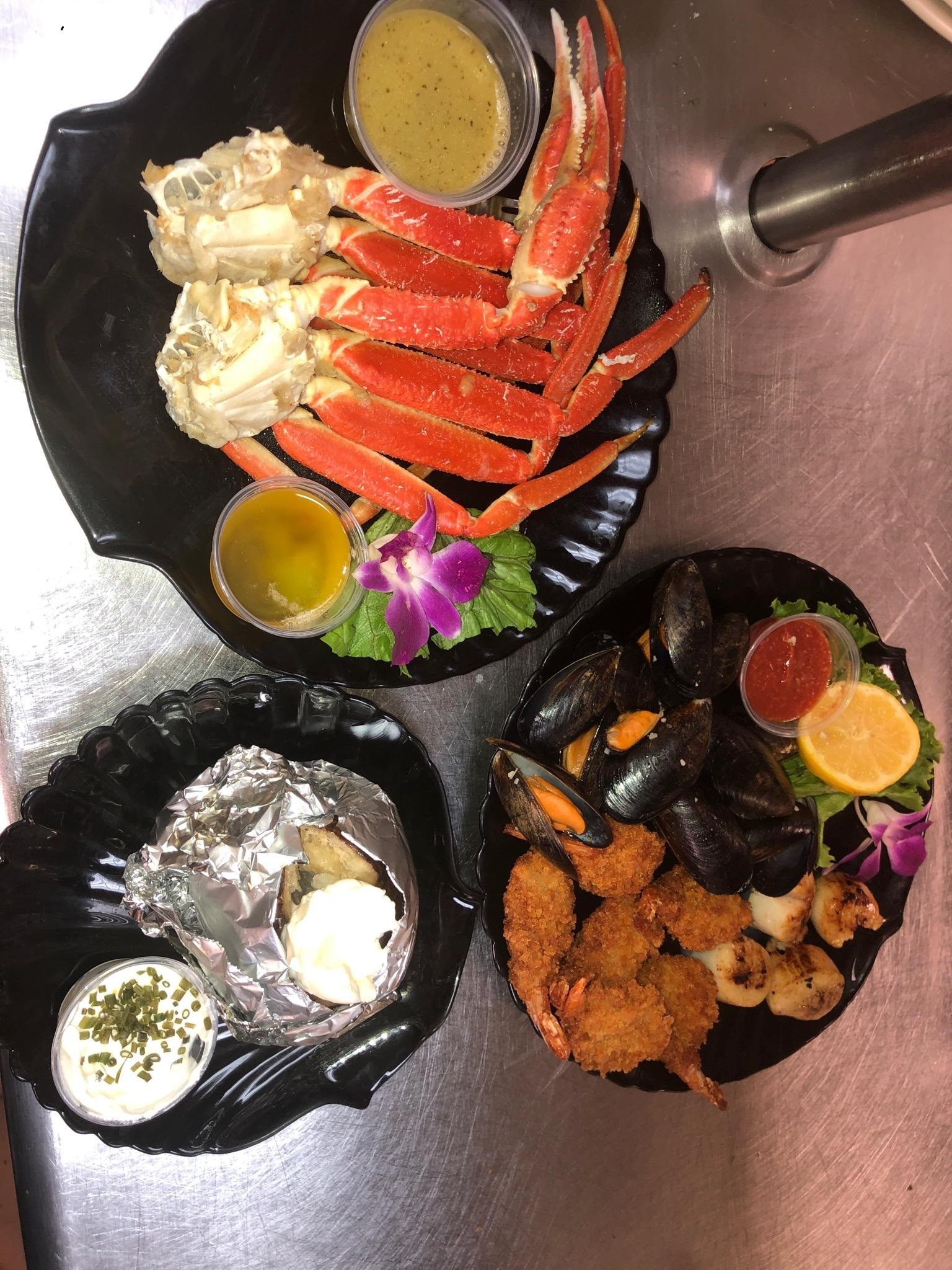"A popular choice on the  Hartford House menu is ""Taste of the Oceans,"" according to cook Hunter Foltz. The entree includes Northern Atlantic snow crab, Gulf shrimp, Mediterranean mussels and sea scallops. (Submitted photo)"