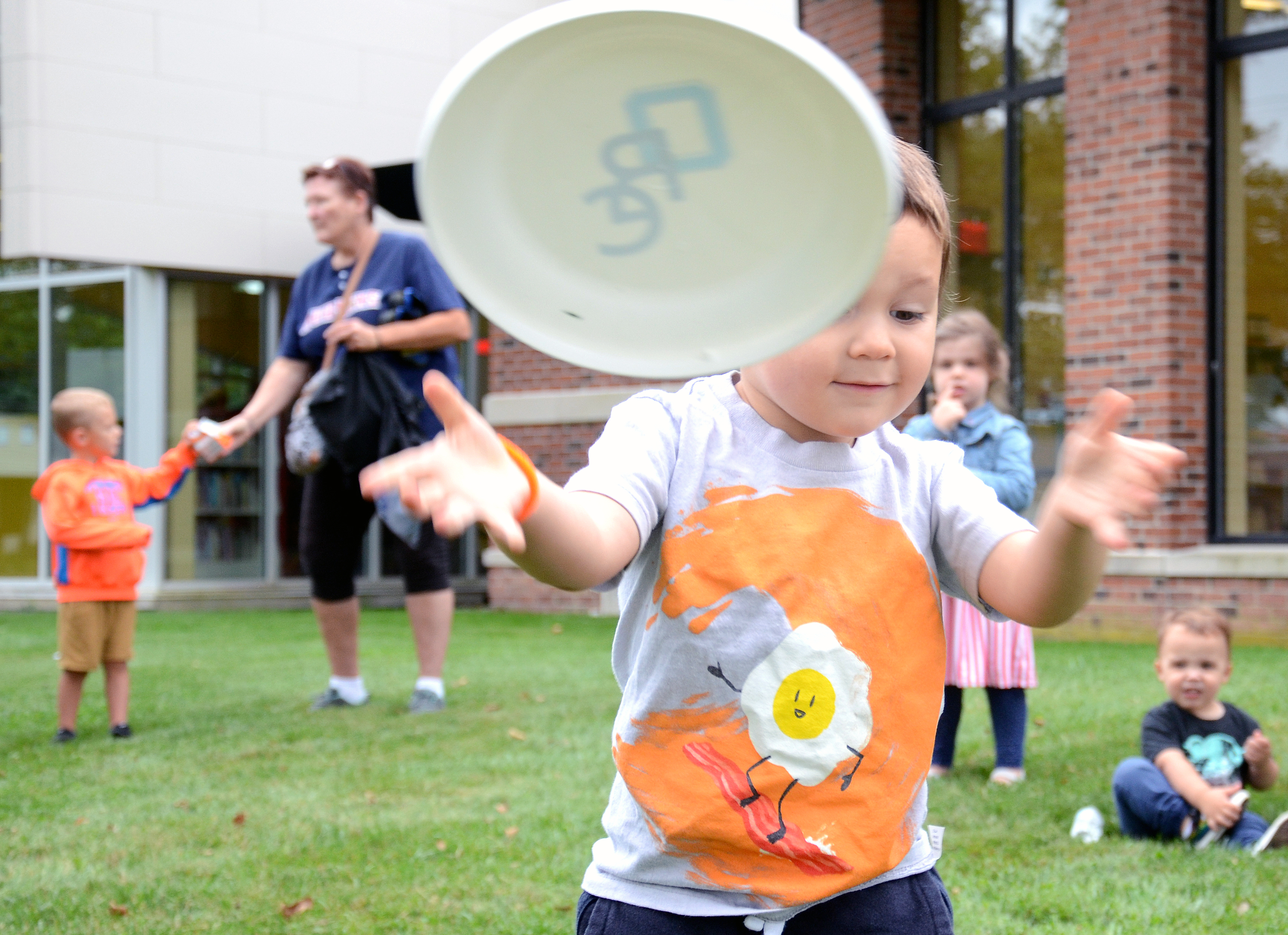 Tobias Balderez, age 3, Toledo, enjoys the outdoor activities at the Dolly Parton Imagination Library kickoff held at the Oregon Branch Library. (Press photo by Ken Grosjean)