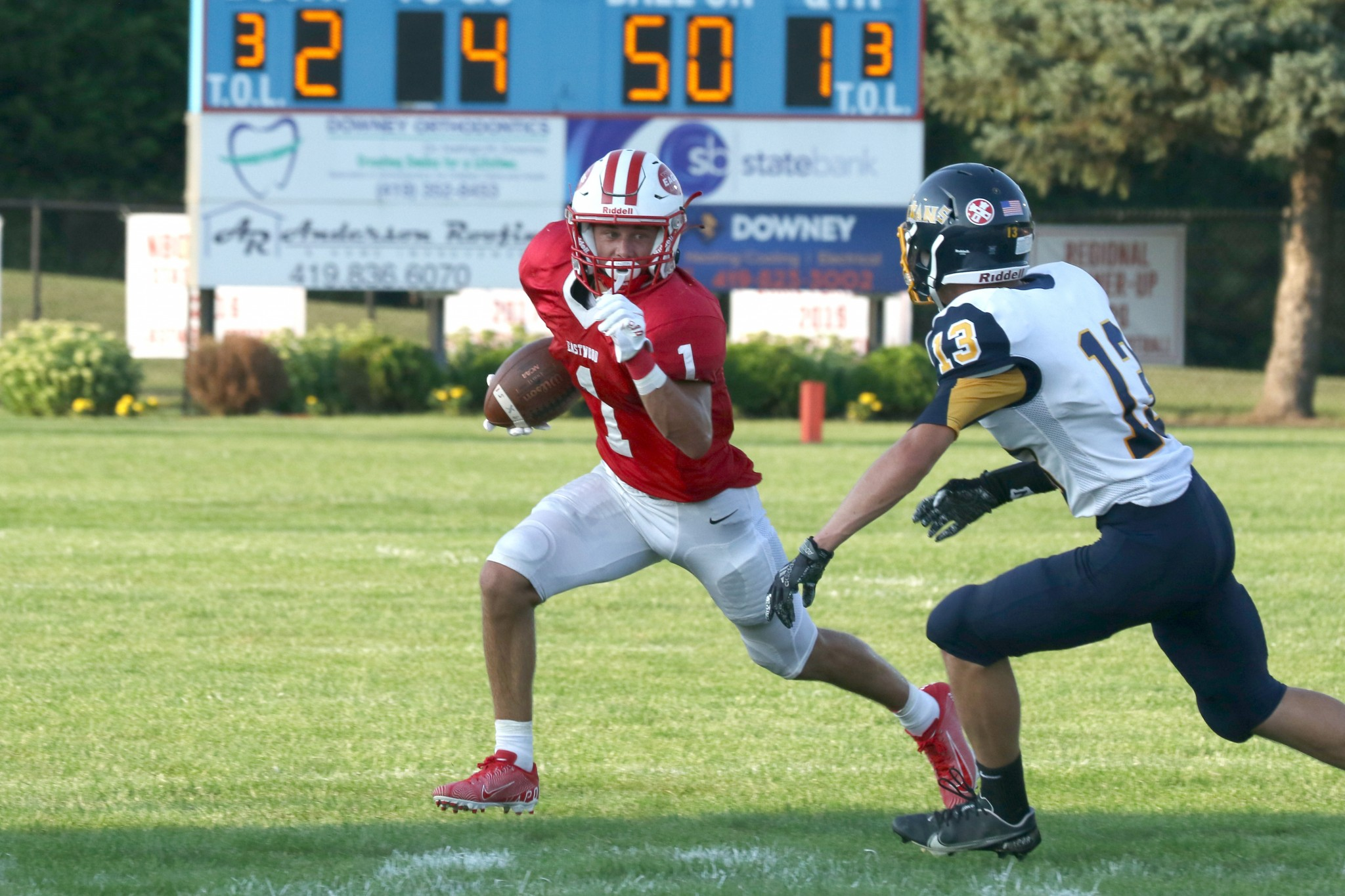 """Eastwood junior back Case Boos puts a move on an Ottawa-Glandorf defender as the Eagles put up 42 points. (Press photo by Lee Welch/<a href=""""http://www.FamilyPhotoGroup.com"""">www.FamilyPhotoGroup.com</a>)"""