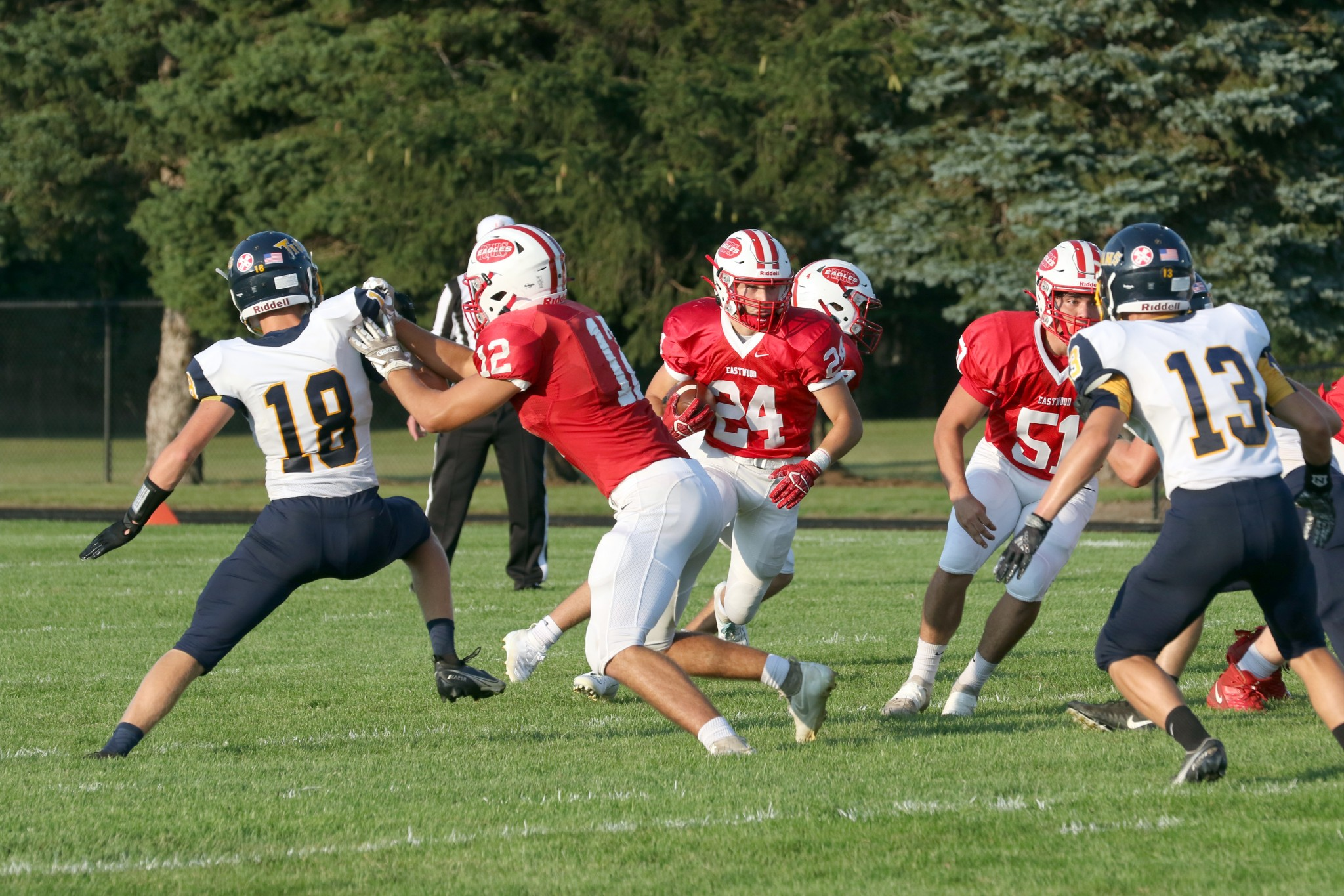 """Eastwood junior back Bryce Koprowski-Kistner gets good blocking during the Eagles' win over Ottawa-Glandorf. (Press photo by Lee Welch/<a href=""""http://www.FamilyPhotoGroup.com"""">www.FamilyPhotoGroup.com</a>)"""