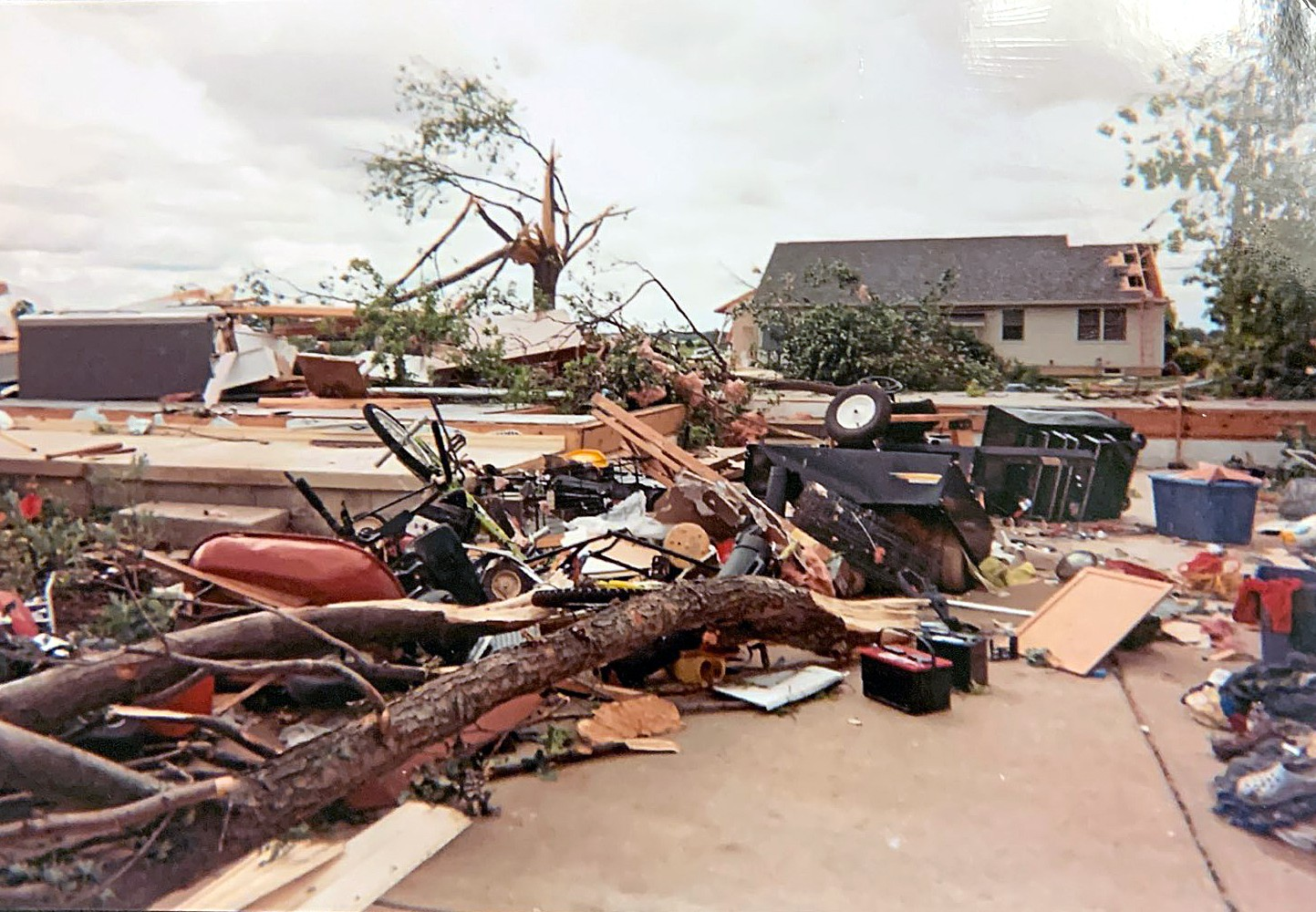 """Then all of a sudden, we smelled gas. Hot water was pouring down onto our shoulders,"" said Sue LaVoy whose Neill Avenue home in Moline was leveled by the tornado. (Photo courtesy of Sue LaVoy)"
